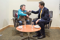 © Licensed to London News Pictures. 19/01/2015. London, UK Marian Janner, founder of Star Wards with her service dog Buddy. Deputy Prime Minister Nick Clegg and the Minister of State for Care and Support, Norman Lamb, host a mental health conference on Monday 19 January 2015 at The King's Fund London. Photo credit : Stephen Simpson/LNP