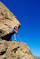 Male climber on rock formation against blue sky Smith Rock State Park Oregon USA