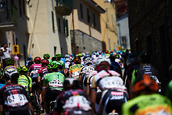 Peloton weave through narrow streets at Giro Rosa 2018 - Stage 2, a 120.4 km road race starting and finishing in Ovada, Italy on July 7, 2018. Photo by Sean Robinson/velofocus.com