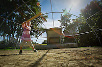 Jaden Francis, 5, closes his eyes and swings away while playing baseball with his father, Chris, during an outing Monday at McEuen Park in downtown Coeur d'Alene.