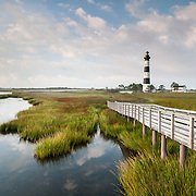 Summer naturally draws one to the coast.  In North Carolina, that means the Outer Banks (OBX) and the Cape Hatteras National Seashore.  While visiting, one of the iconic landmarks to visit is the historic Bodie Island Lighthouse.  Walk the pedestrian boardwalk out over the marsh to gain views of the coastal ecosystem and the unique daymark painting of the lighthouse itself.