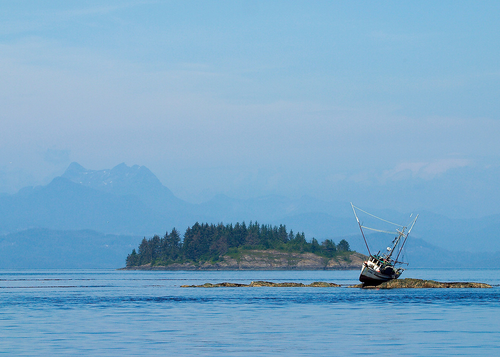 Alaska. Inside Passage. A lowtide shipwreck haunts this fishing vessel.