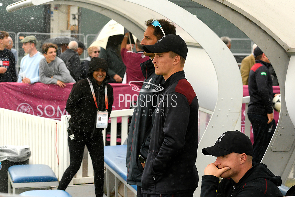 Somerset captain Tom Abell watches on as the umpires inspect the pitch at 2:30pm but heavy rain begins to fall again to further the delay in the start of play during the Specsavers County Champ Div 1 match between Somerset County Cricket Club and Essex County Cricket Club at the Cooper Associates County Ground, Taunton, United Kingdom on 25 September 2019.