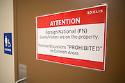 A sign on the restroom door at Exelis Inc. in Rochester, New York reminds employees to be cautious about their conversations in common areas. Exelis is an aerospace and defense company, and employs numerous former Kodak workers in its Rochester facility.