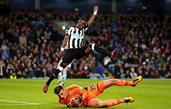 Christian Atsu of Newcastle United jumps over Nick Pope of Burnley - Mandatory by-line: Robbie Stephenson/JMP - 30/10/2017 - FOOTBALL - Turf Moor - Burnley, England - Burnley v Newcastle United - Premier League