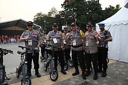 JAKARTA, Aug. 18, 2018  Indonesian policemen pose for pictures before the opening ceremony of the 18th Asian Games in Jakarta, Indonesia, Aug. 18, 2018. The opening ceremony of the 18th Asian Games will be held here Saturday evening. (Credit Image: © Lan Hongguang/Xinhua via ZUMA Wire)