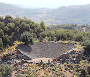 Theatre, 2nd century BC, built in the Greek style, at the base of the city of Pinara, an ancient Lycian city on Mount Kragos, Fethiye, Mugla, Turkey. The theatre holds 3200 and consists of 27 rows divided into 9 wedge sectors by 10 flights of steps. Pinara was founded in the 5th century BC as an extension of the overcrowded Xanthos and was one of the largest cities in Lycia. It was a religious centre dedicated to Apollo, Athena and Aphrodite which later became Christianised and was a bishopric in Byzantine times before being abandoned in the 9th century. The remains of several ancient temples can be seen in Pinara, as well as rock tombs, an upper and lower acropolis, a theatre, an odeon, an agora and a church. Picture by Manuel Cohen