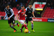 Anthony Forde of Walsall FC on the ball, under pressure from Edward Upson of Millwall FC and Shane Ferguson of Millwall FC during the Sky Bet League 1 match between Walsall and Millwall at the Banks's Stadium, Walsall, England on 6 February 2016. Photo by Mike Sheridan.