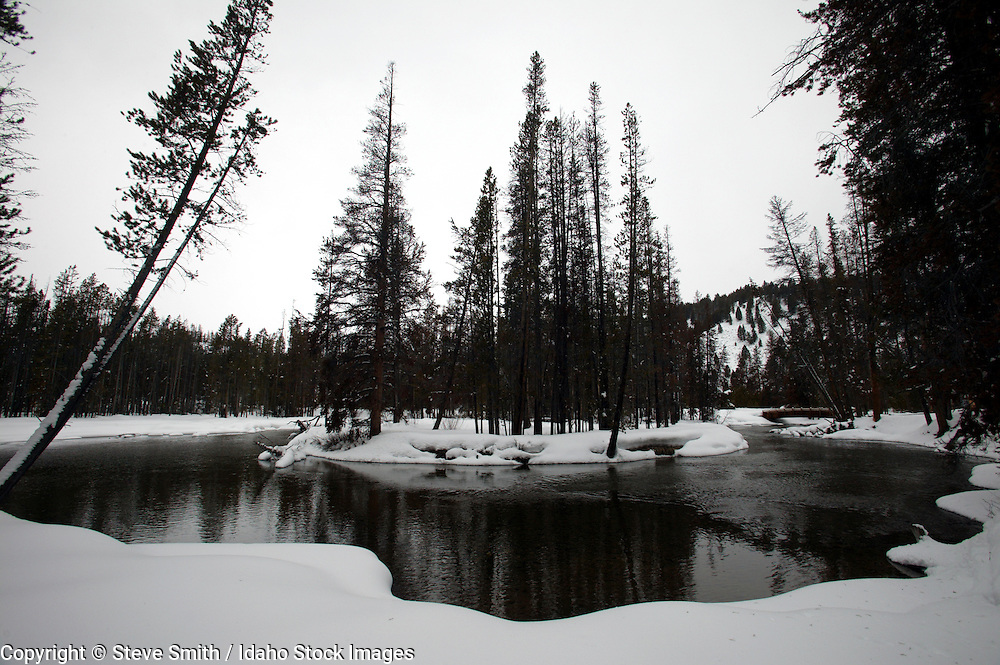 Horizontal view of icy Redfish Creek as it meanders thru winter landscape in Sawtooth nat'l Forest, Stanley, Idaho