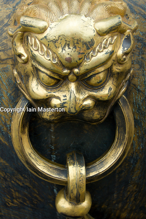 Dey¥tail of ornate bronze handle in shape of lion   in Forbidden City Beijing