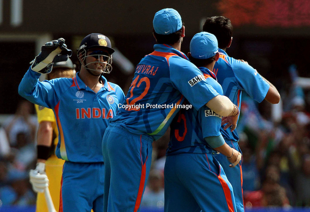 Indian bowler R. Ashwin celebrating with captain MS Dhoni and team mates the shane watson ICC Cricket World cup 2011, 2nd Quarter final match between India and Australia on 24th March 2011, at Motara Cricket Stadium in Ahemdabad,