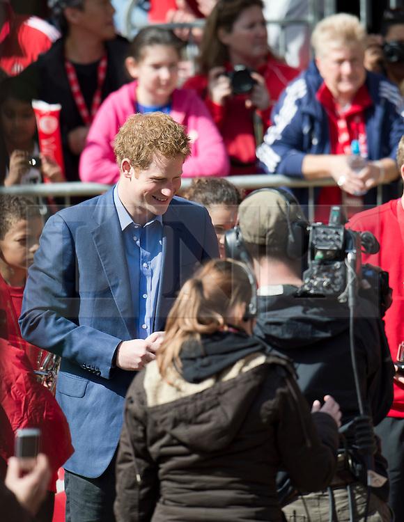 © London News Pictures. 22/04/2012. London, UK. HRH Prince Harry presenting awards to the winners of the Mini Marathon event before the 2012 Virgin London Marathon on April 22, 2012. Photo credit : Ben Cawthra /LNP