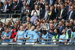 The trophy is placed on the head of Raheem Sterling - Mandatory by-line: Arron Gent/JMP - 18/05/2019 - FOOTBALL - Wembley Stadium - London, England - Manchester City v Watford - Emirates FA Cup Final