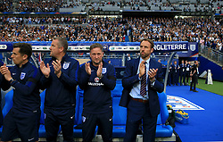 England manager Gareth Southgate (right) applauds with the England management team