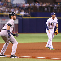 New York Yankees shortstop Derek Jeter (2) watches the ball for a tag up during a major league baseball game between the New York Yankees and the Tampa Bay Rays at Tropicana Field on Thursday, Sept. 17, 2014 in St. Petersburg, Florida. The Yankees won the game 3-2 and this was Jeter's last game against Tampa Bay. (AP Photo/Alex Menendez)