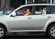 9/12/12 7:05:43 PM - Yardley, PA.. -- An unidentified woman makes a goofy face as a dog hangs it's head out the rear window September 12, 2012 in Yardley, Pennsylvania. -- (Photo by William Thomas Cain/Cain Images)