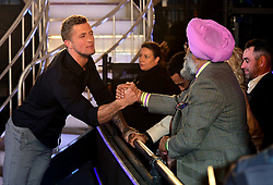 Dan Osborne hakes hands with Hardeep Singh Kohli after he leaves the house after finishing in third place during the live final of Celebrity Big Brother at Elstree Studios, Hertfordshire.