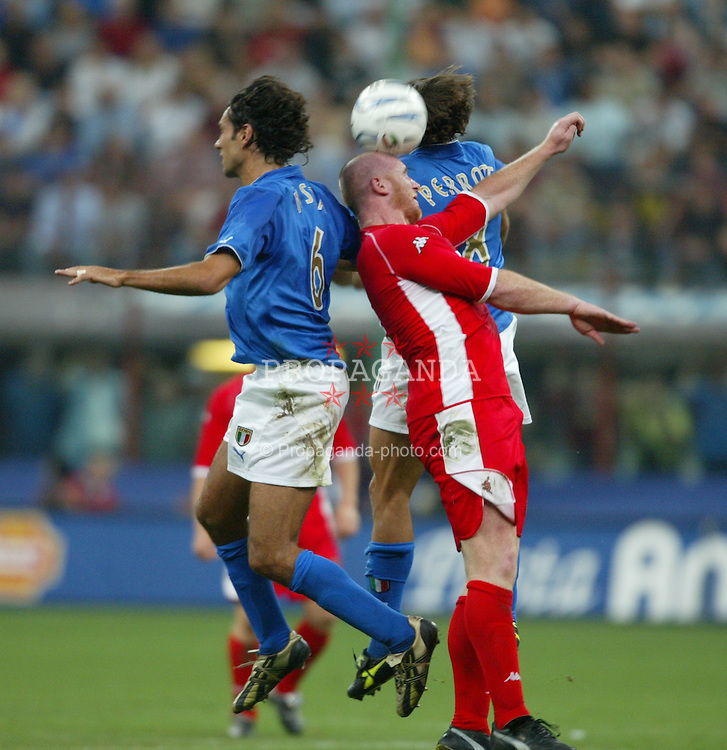 MILAN, ITALY - Saturday, September 6, 2003: Wales' John Hartson challenges for a header with Italy's Alessandro Nesta (l) and Simone Perrotta (r) during the Euro 2004 qualifying match at the San Siro Stadium. (Pic by David Rawcliffe/Propaganda)