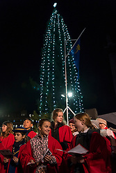 © Licensed to London News Pictures. 01/12/2016. London, UK. The Choir of St Martins-in-the-Fields, Children's Voices Choir sing carols as a 22-metre tall Norwegian spruce, decorated in a traditional Norwegian style with vertical strings of lights (around 770 energy-efficient light bulbs) is lit up in Trafalgar Square.  The tree is the city of Oslo's traditional Christmas gift to London as a token of thanks for British support during the years of occupation.  The Lord Mayor of Westminster, Councillor Steve Summers hosted the Mayor of Oslo, Marianne Borgen who performed the official lighting up. Photo credit : Stephen Chung/LNP