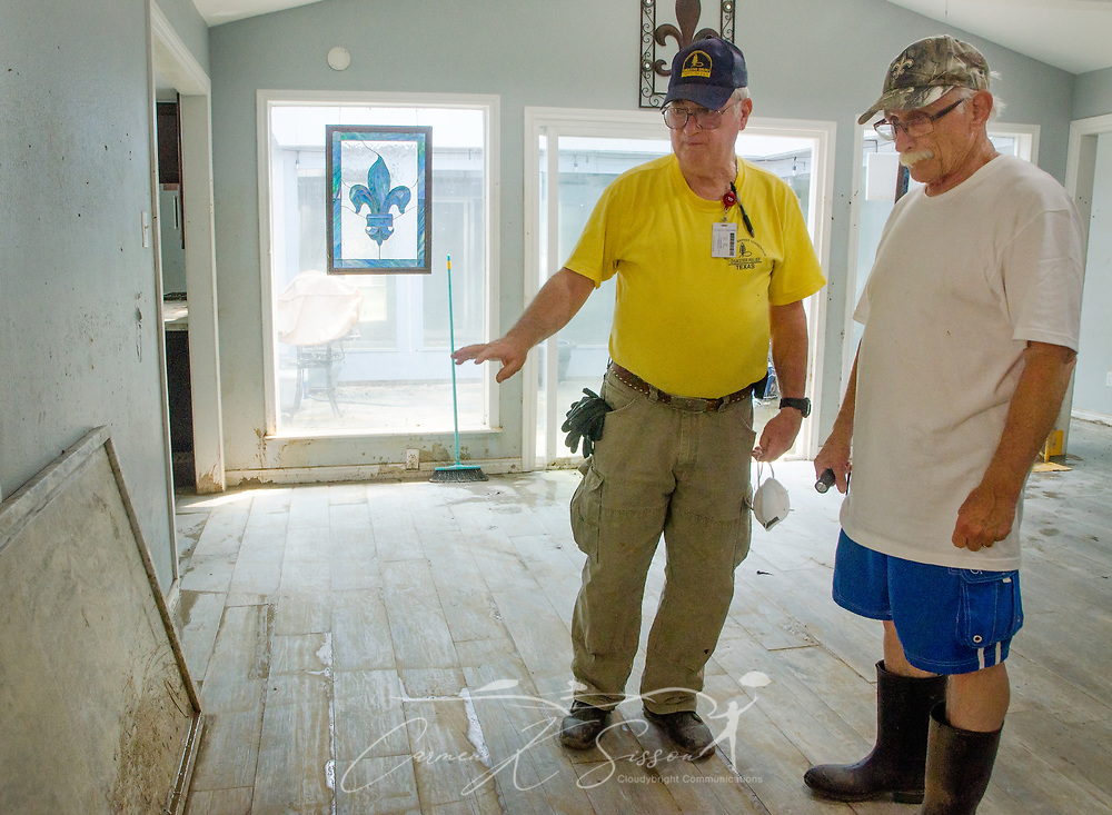Southern Baptist Disaster Relief unit leader Brian Batchelder, of Broadview Baptist Church in Abilene, Texas; discusses cleanup efforts with homeowner Paul Matlock; Sept. 6, 2017, in Houston, Texas. Matlock's home was inundated with more than six feet of water when Hurricane Harvey dumped more than 51 inches of rainfall in mid-August. Approximately 70 people died in the U.S. due to the hurricane and flooding, but that number is expected to rise as water levels fall, allowing rescuers to reach more areas. (Photo by Carmen K. Sisson