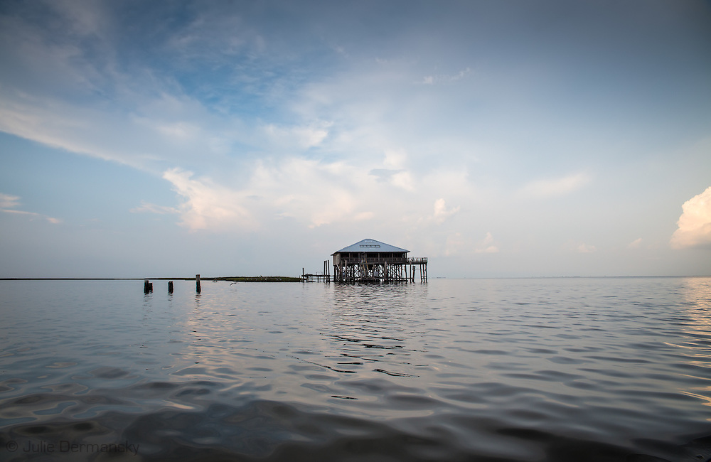 A fishing camp in the waters off Isle de Jean Charles deep in the bayous of Terrebonne Parish in South Louisiana. The marsh land is disappearing at a fast clip due to coastal erosion.