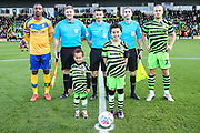 Mascots with officials and captains during the EFL Sky Bet League 2 match between Forest Green Rovers and Mansfield Town at the New Lawn, Forest Green, United Kingdom on 19 October 2019.