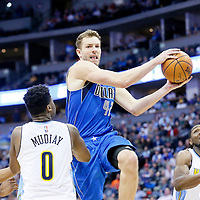 06 March 2016: Dallas Mavericks forward David Lee (42) goes for the layup past Denver Nuggets guard Emmanuel Mudiay (0) and Denver Nuggets forward Kenneth Faried (35) during the Denver Nuggets 116-114 overtime victory over the Dallas Mavericks, at the Pepsi Center, Denver, Colorado, USA.