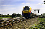 An East midlands Train passes through Northamptonshire between the village of Isham and the town of Burton Latimer heading towards Kettering
