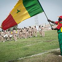 11/06/2013. Stade Iba Mar Diop, Dakar, Senegal. Fanfare militaire senegalaise pendant que les joueurs de l'équipe de rugby du Senegal se préparent à disputer premier match de la demi-finale de la Coupe d'Afrique des Nations B contre la Namibie. ©Sylvain Cherkaoui