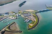 Nederland, Friesland, Groningen, Lauwersoog, 04-11-2018; Haven en Veerhaven voor veerdienst naar Schiermonnikoog. Schutsluis Robbengatsluis tussen Lauwersmeer en Waddenzee, afsluitdijk met R.J. Cleveringsluizen, de spuisluizen.<br /> Lauwersmeer and harbour on the border between Groningen and Friesland, Wadden sea and former Lauwers sea.<br /> <br /> luchtfoto (toeslag op standaard tarieven);<br /> aerial photo (additional fee required);<br /> copyright © foto/photo Siebe Swart