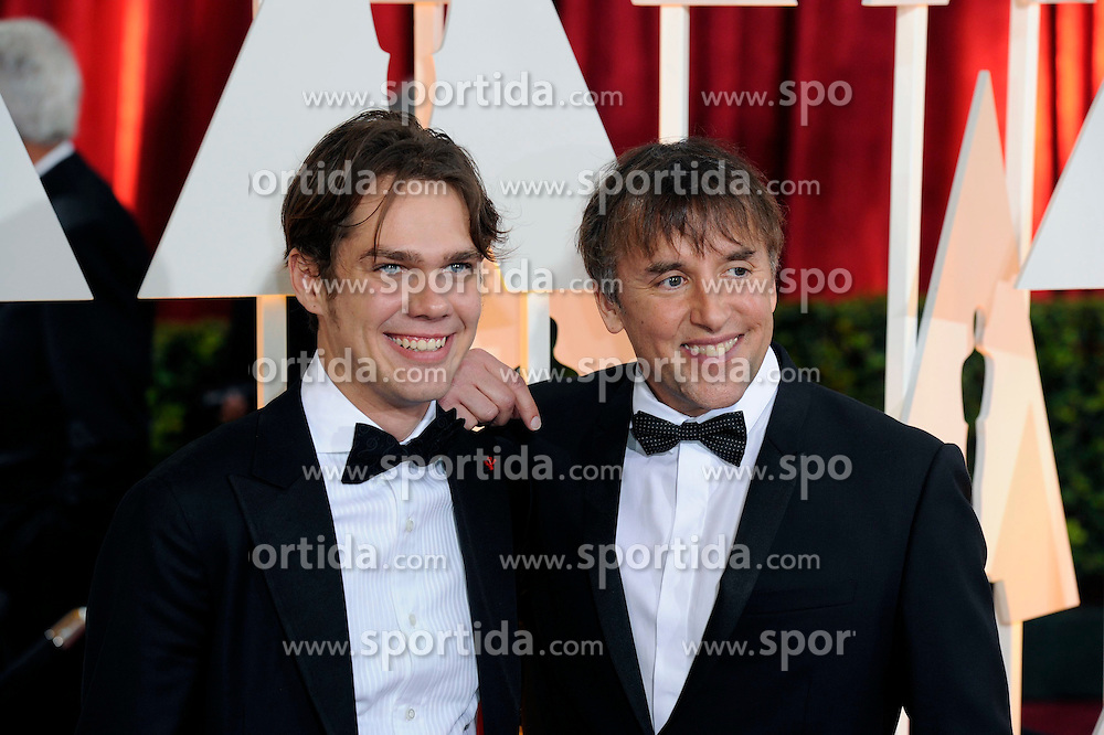 Director Richard Linklater (R) and actor Ellar Coltrane of &quot;Boyhood&quot; arrive for the red carpet of the 87th Academy Awards at the Dolby Theater in Los Angeles, the United States, on Feb. 22, 2015. EXPA Pictures &copy; 2015, PhotoCredit: EXPA/ Photoshot/ Yang Lei<br /> <br /> *****ATTENTION - for AUT, SLO, CRO, SRB, BIH, MAZ only*****