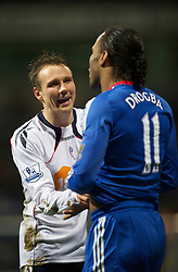 BOLTON, ENGLAND - Monday, January 24, 2011: Chelsea's Didier Drogba clashes with Bolton Wanderers' Matthew Taylor after feigning injury to win a free-kick during the Premiership match at the Reebok Stadium. (Photo by David Rawcliffe/Propaganda)
