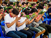 "30 DECEMBER 2017 - BANG KRUAI, NONTHABURI, THAILAND:  People pray to make merit for the new year at Wat Ta Khien, about 45 minutes from Bangkok in Nonthaburi province. The temple is famous for the ""floating market"" on the canal that runs past the temple and for the ""resurrection ceremonies"" conducted by monks at the temple.      PHOTO BY JACK KURTZ"