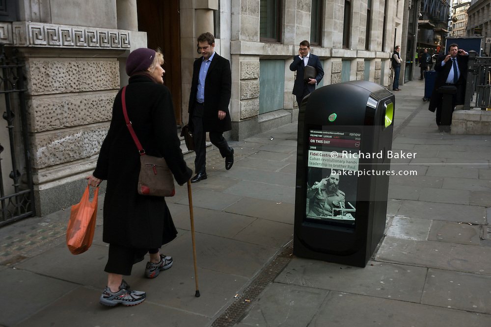 New media showing news feed of Fidel Castro's handover of power in a side street in the capital's financial district.
