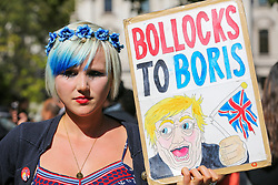 © Licensed to London News Pictures. 17/09/2019. London, UK. A protester with a placard outside UK Supreme Court in London as the court begins a three day appeal hearing in the multiple legal challenges against the Prime Minister Boris Johnson's decision to prorogue Parliament ahead of a Queen's speech on 14 October. Eleven instead of the usual nine Supreme Court justices will hear the politically charged claim that Boris Johnson acted unlawfully in advising the Queen to suspend parliament for five weeks in order to stifle debate over the Brexit crisis.It is the first time the Supreme Court has been summoned for an emergency hearing outside legal term time.Lady Hale, the first female president of the court who retires next January, will preside. Photo credit: Dinendra Haria/LNP