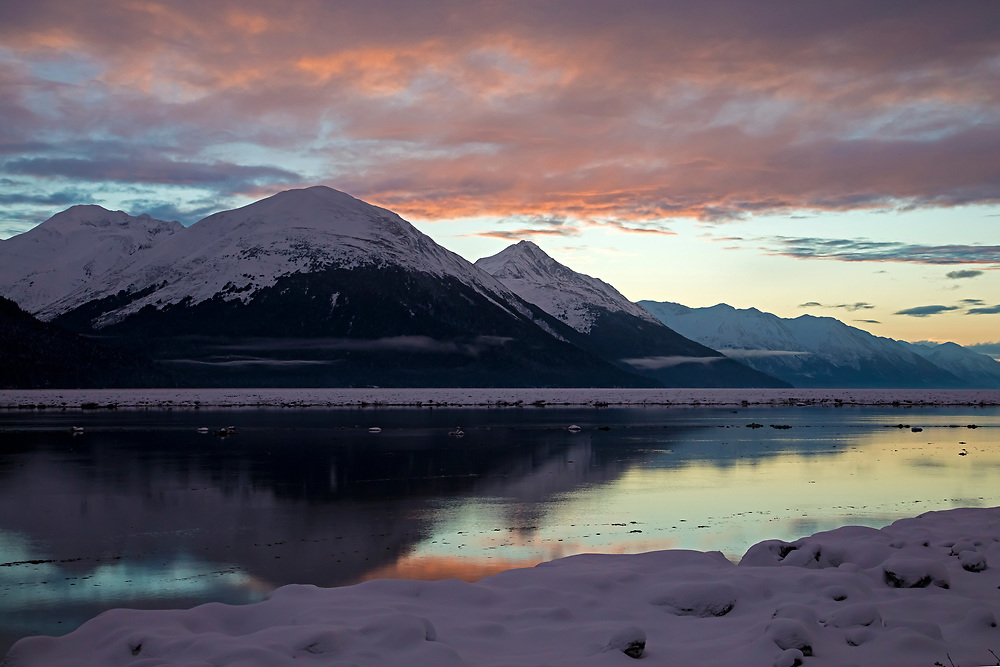 Winter scenic of Turnagain Arm/Cook Inlet at sunset as viewed from the Seward Highway.