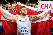 Great Britain, London - 2017 August 11: Pawel Fajdek (Agros Zamosc) of Poland celebrates with his supporters gold medal in men&rsquo;s hammer throw final during IAAF World Championships London 2017 Day 8 at London Stadium on August 11, 2017 in London, Great Britain.<br /> <br /> Mandatory credit:<br /> Photo by &copy; Adam Nurkiewicz<br /> <br /> Adam Nurkiewicz declares that he has no rights to the image of people at the photographs of his authorship.<br /> <br /> Picture also available in RAW (NEF) or TIFF format on special request.<br /> <br /> Any editorial, commercial or promotional use requires written permission from the author of image.