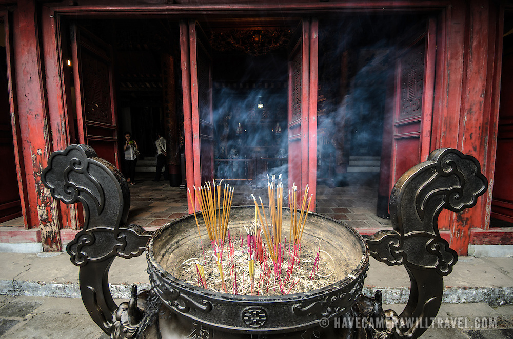 Incense burning at the Temple of the Jade Mountain (Ngoc Son Temple) on Hoan Kiem Lake in the heart of Hanoi's Old Quarter. The temple was established on the small Jade Island near the northern shore of the lake in the 18th century and is in honor of the 13-century military leader Tran Hung Dao.