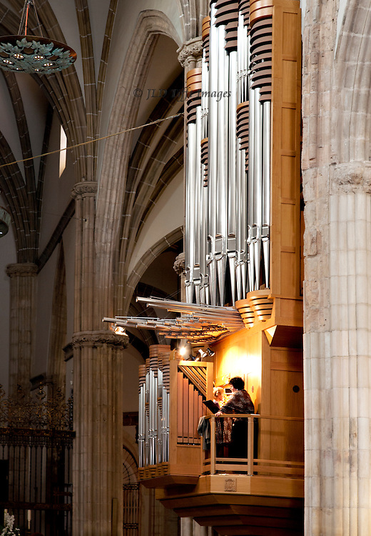 Cathedral at Alcala de Henares, interior, showing organ with singer and organist at practise.
