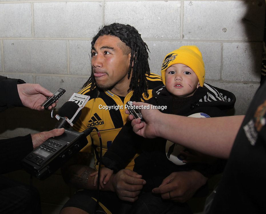Hurricanes 38 V Lions 27 Westpac Stadium.Wellington 4.6.2011 Ma'a Nonu faces up the media with two and half year old son Mercury after team victory.bush pic 1