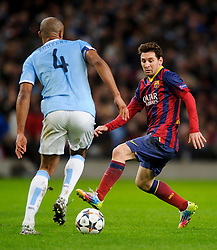 Man City Defender Vincent Kompany (BEL) is challenged by Barcelona Midfielder Lionel Messi (ARG) - Photo mandatory by-line: Rogan Thomson/JMP - Tel: 07966 386802 - 18/02/2014 - SPORT - FOOTBALL - Etihad Stadium, Manchester - Manchester City v Barcelona - UEFA Champions League, Round of 16, First leg.