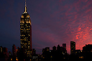 A dramatic sunset behind the Empire State Building in Manhattan, New York City, New York State, U.S.A.