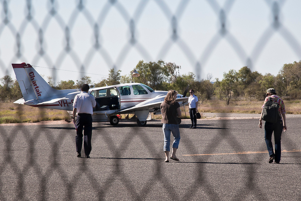 Dr. Clare McVicar and Nurse Karen walk to the plane with the Pilot, destined for the remote Ablriginal Community of Docker River for a 2 day clinc.