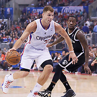 16 November 2013: Los Angeles Clippers power forward Blake Griffin (32) drives past Brooklyn Nets Tyshawn Taylor during the Los Angeles Clippers 110-103 victory over the Brooklyn Nets at the Staples Center, Los Angeles, California, USA.