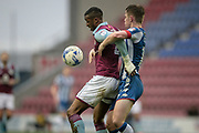 Jonathan Kodjia (Aston Villa) and Callum Connolly (Wigan Athletic) fight for the ball as it bounces during the EFL Sky Bet Championship match between Wigan Athletic and Aston Villa at the DW Stadium, Wigan, England on 18 March 2017. Photo by Mark P Doherty.