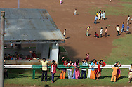 View of children at school waving  at the passing steam train  (taken from the train) near Ooty, Tamil Nadu India..
