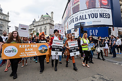 "© Licensed to London News Pictures. 29/05/2017. London UK. TV wildlife presenter Anneka Svenska and model Daryna Milgevska in fox costume and body paint join demonstrators in an ""Anti-Hunting March"" in central London, marching from Cavendish Square to outside Downing Street.  Protesters are demanding that the ban on fox hunting remains, contrary to reported comments by Theresa May, Prime Minister, that the 2004 Hunting Act could be repealed after the General Election.<br />  Photo credit : Stephen Chung/LNP"