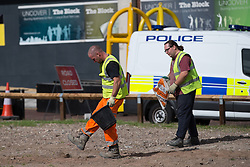 © Licensed to London News Pictures . 23/09/2016 . Liverpool , UK . Workmen remove rocks from derelict ground by the perimeter of the conference venue , as a precaution against them being used by protesters or vandals . Preparations at the Liverpool Arena and Convention Centre ahead of the Labour Party Leadership Declaration and 2016 Conference . Photo credit : Joel Goodman/LNP