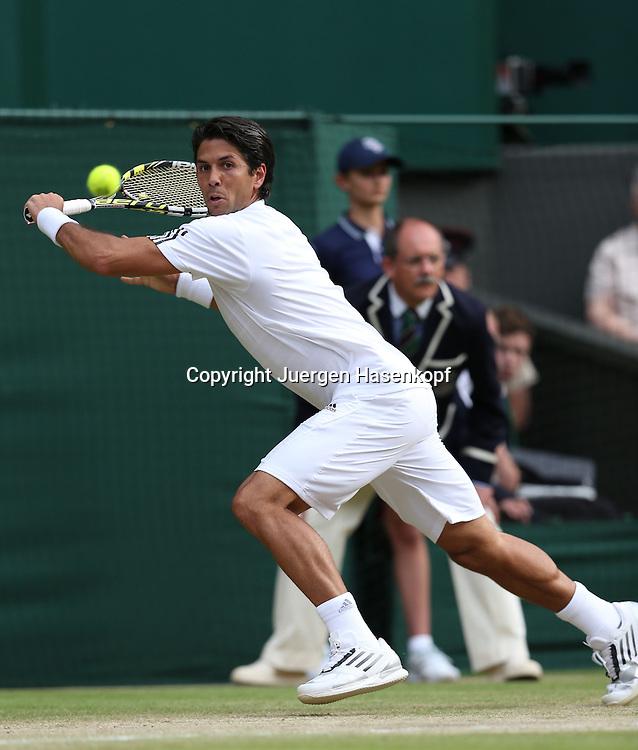 Wimbledon Championships 2013, AELTC,London,<br /> ITF Grand Slam Tennis Tournament,<br /> Fernando Verdasco (ESP),Aktion,Einzelbild,<br /> Ganzkoerper,Hochformat,