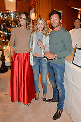 Left to right, LOUISE ROE, CAGGIE DUNLOP and SCOTT SULLIVAN at a party to celebrate the publication of Front Roe by Louise Roe held at Ralph Lauren, 1 New Bond Street, London on 1st April 2015.
